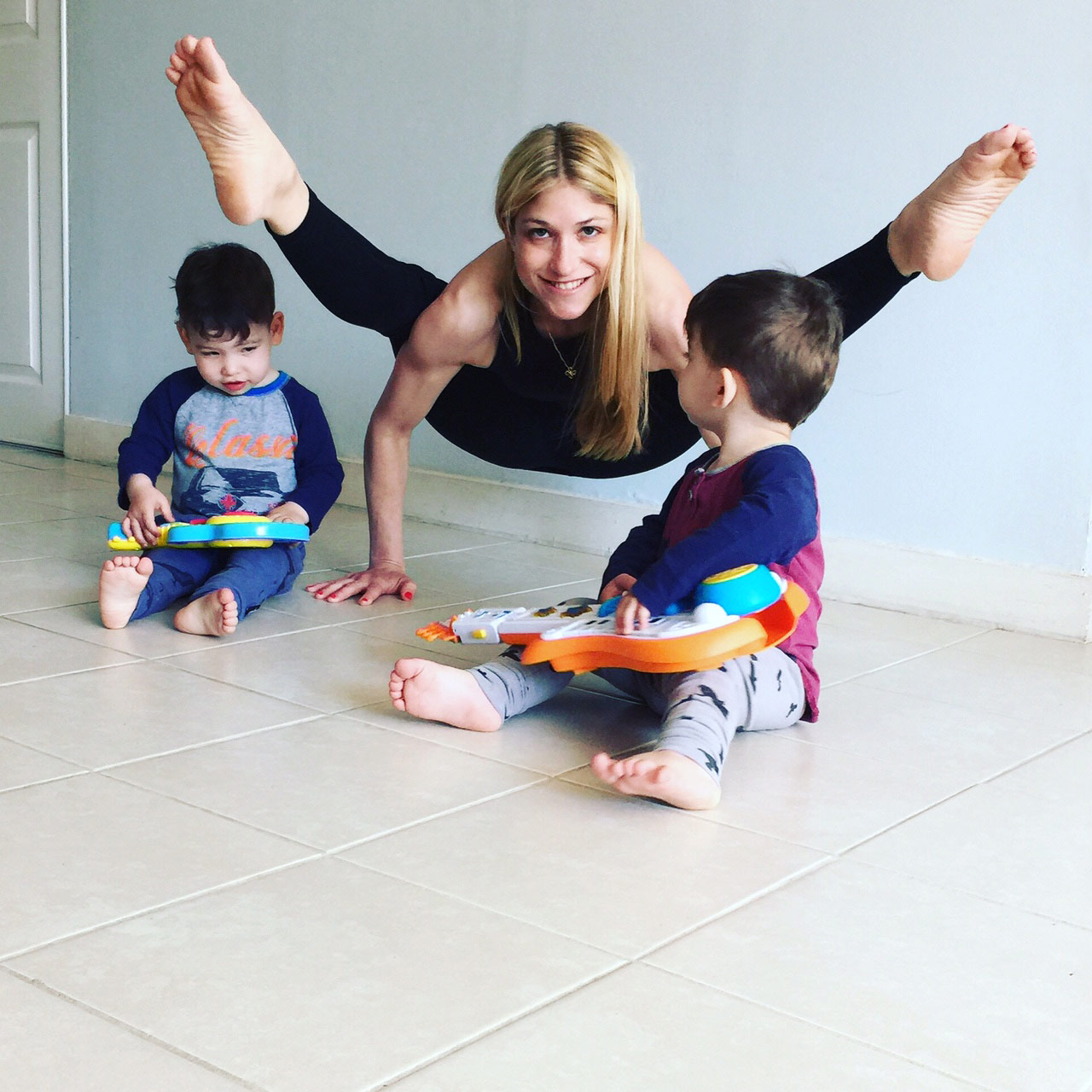 View larger photo of yoga instructor doing yoga with toddlers
