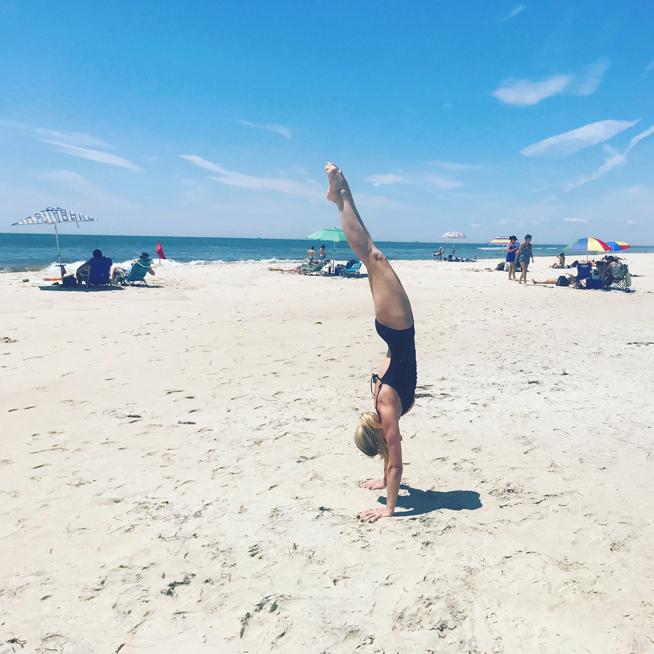 Click to see a larger version of Goldie Oren's Perfect handstand on the beach