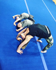 Goldie Oren doing yoga with twin boys